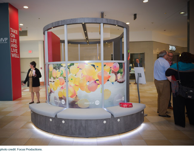 Charging stations and seating at the MVP healthcare mall kiosk