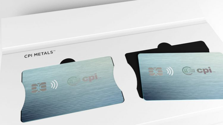 Close up of credit card packaging open with two credit cards lying on top.