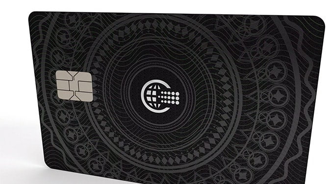 Close up of credit card with decorative pattern.