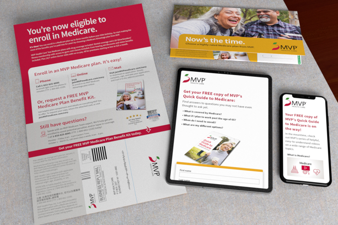 Self mailer on grey, granite counter top with a black tablet and cell phone displaying an MVP landing page