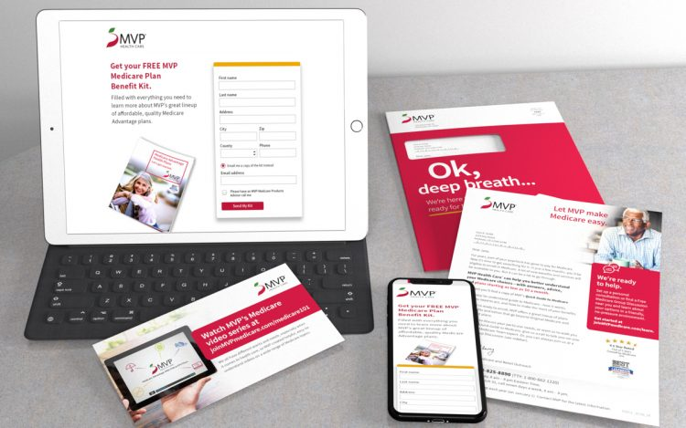 Tablet and cell phone displaying MVP's landing page along with a slef mailer package including a letter and buckslip