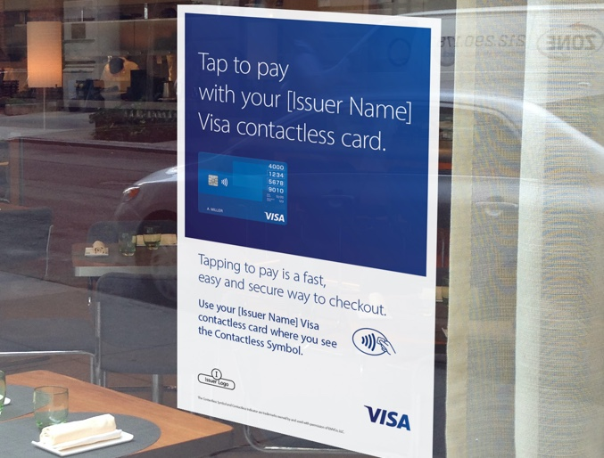 Visa Contactless Card poster displayed on restaurant glass window front