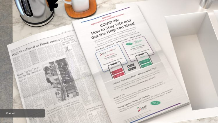 Newspaper showing print ad laying on kitchen sink.