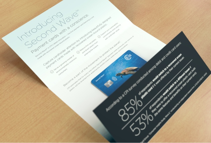 Opened CPI direct mailer, with new ocean plastic card on wooden table top