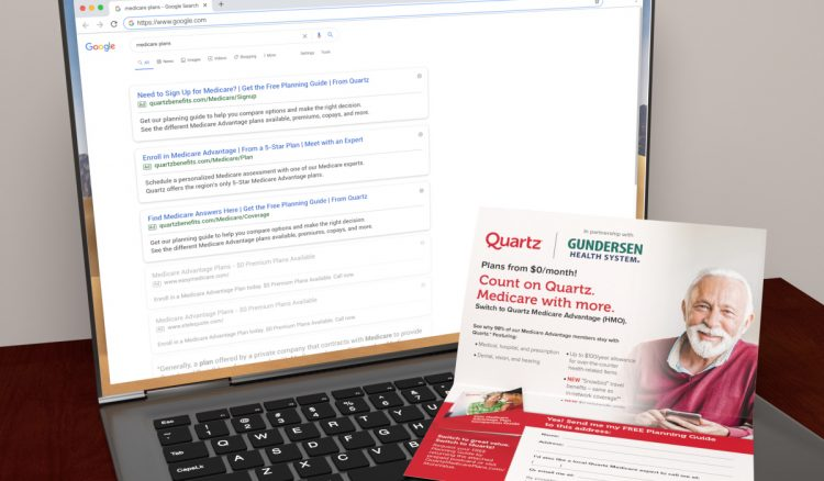 An open laptop displaying Quartz paid search results on Google with a Quartz FSI