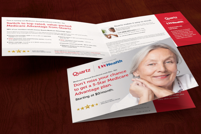 Close up cover of a Quartz self mailer with another also opened to see the inside