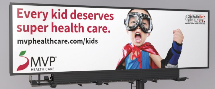 MVP Child Health Plus billboard with young boy dressed as a superhero